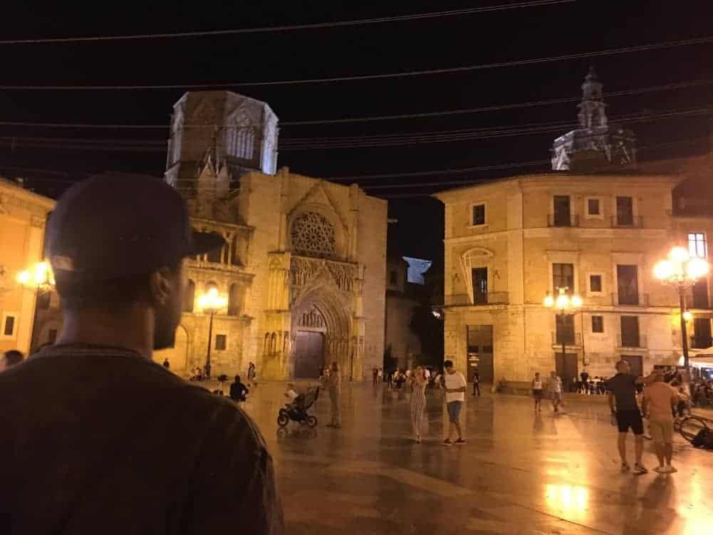 Man looking at the Plaza de la Virgen in Valencia