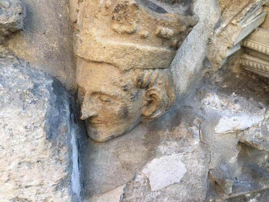 Roman statue head in a wall by la Estrecha in Valencia